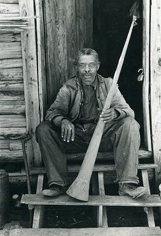 Horn Of Pain  A former slave (name unknown) holds a horn once used to call slaves who were tolling out in the fields.