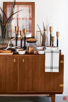 Planning a fall get-together? No problem. Turn everyday furniture, like a console table, into a serving station for anything from apps to drinks or dessert—pie bar, anyone? Dress things up with décor, like tapered candles and vases with festive fillers, to tie it into rest of the space.Then, bring on the party!
