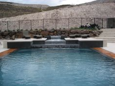 Luxury swimming pool with waterfall feature