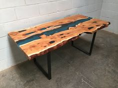 Pippy Yew River Table with blue resin fill.