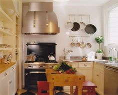 in a small kitchen, select petite islands, slim chairs, streamlined stools and narrow tables that don't eat up valuable floor space. Avoid chunky furniture legs or thick bases, which add visual bulk.