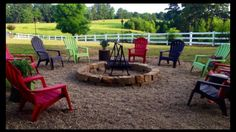 Adirondack chairs surround fire pit with a panoramic view.