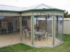 External view of enclosed pergola with hip ends and slatted frieze with Paved floor and clear PVC blinds