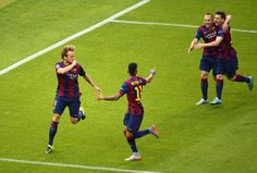 Ivan Rakitic (L) of Barcelona celebrates scoring the opening goal with team mates during the UEFA Champions League Final between Juventus and FC Barcelona at Olympiastadion on June 6, 2015 in Berlin, Germany.