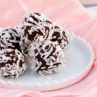 Coconut Cacao Truffles from our blog - These creamy, fudgy truffles are soooo decadent (but healthy!) They're the perfect treat for any holiday or special celebration.