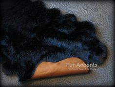 WHAT KIND OF ANIMAL IS A FAUX? ITS NOT! ITS FAUX FUR by FURACCENTS.COM!  BE KIND TO ANIMALS ALWAYS BY FAUX. THIS IS A FAKE SHEEPSKIN ACCENT RUG AND ITS STUNNING