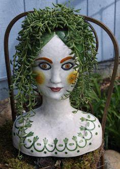 Antique head planter.  I love her.