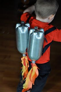 jet pack: coke bottles, spray paint , some back pack strap material stuff, and some red, orange, and yellow fabric.