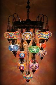 Unique Chandelier..DIY..this would be great using mosaic or paint..a bit boho and Moroccan.