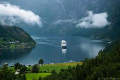 The beautiful Geiranger Norway - Geiranger is a small tourist village in Sunnmøre region of Møre og Romsdal county in the western part of Norway. It lies in Stranda at the head of the Geirangerfjorden, which is a branch of the large Storfjorden. The nearest city is Ålesund. Geiranger is home to some of the most spectacular scenery in the world, and has been named the best travel destination in Scandinavia by Lonely Planet. Since 2005, the Geirangerfjord area has been listed as a UNESCO…