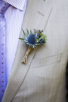 Boutonniere Blue Thistle with Privet Berries. Thistle Boutonniere, Corsage And Boutonniere, Groom Boutonniere, Boutonnieres, Purple Boutonniere, Ranunculus Boutonniere, Winter Boutonniere, Thistle Bouquet, Thistle Flower