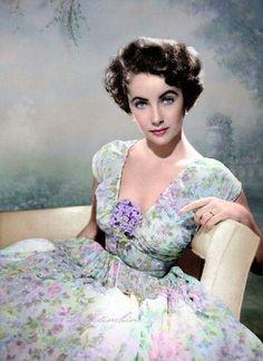 Elizabeth in a beautiful floral dress.
