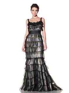 """Badgley Mischka Couture  Tiered Lamé Gown  Silver and gold lamé with contrasting tiered tulle overlay, circular beaded and jeweled embellishments at neckline, banded waist, fit and flare skirt, hidden back zipper, slight train, fully lined with silkFabric: 70% Silk/30% PolyesterLining: 100% SilkCare instructions: Spot cleanMeasurements: shoulder to hemline 65""""Country of origin: United States"""