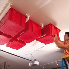 Build this simple, slide-in storage system for your garage. f your garage is running out of space, try building this overhead storage system. The construction is simple and fast, and the whole system is made with standard materials. Garage Ceiling Storage, Overhead Garage Storage, Garage Storage Systems, Garage Organization, Organized Garage, Organization Ideas, Basement Storage, Organizing Tips, Workshop Organization