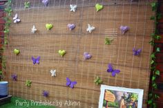 Such a creative backdrop at a Tinkerbell party! See more party ideas at CatchMyParty.com! #partyideas #tinkerbell