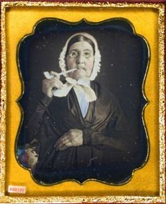 ca. 1850's, [Daguerreotype portrait of an elderly woman smoking a clay pipe] via the Daguerreian Society, Matthew R. Isenburg Collecti...