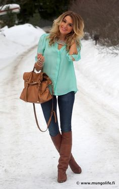 loose chiffon blouse, with a statement necklace, large satchel bag, skinny jeans and knee high boots.