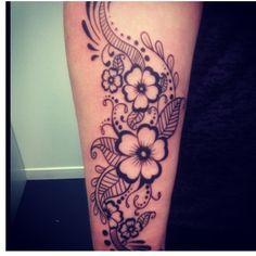 Feminine tribal floral tattoo