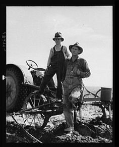 Dust bowl farmer with tractor and young son near Cland, New Mexico