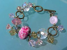 Bracelet with Crystal Beads, Glass Beads and Antiqued Gold Rings - Fire Mountain Gems and Beads