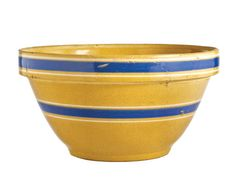 """The Yellowware Bowl  Then: The Original  ORIGIN American, early 1900s.  ORIGINAL USE Potteries throughout the United States produced pressed, molded, or thrown mixing and serving bowls. These 3"""" to 18"""" diam. nesting bowls were clear-glazed to emphasize the natural pale yellow to dark mustard clay. Bowls were often decorated with bands."""