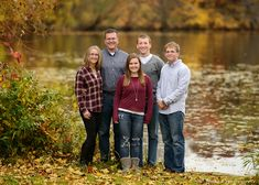 Fall family photos with teens and older kids, adult children by a lake.