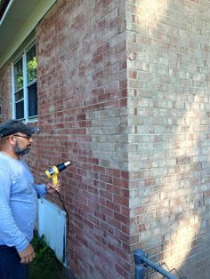 Yes! Staining the ugly yellow brick charcoal gray rather than ...
