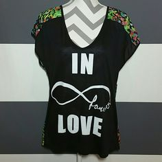 """In forever love"" t-shirt NWOT Made in the U.S.A.  Brand new without tags   ""In forever love"" t-shirt. Amazing to pair with short and sandals or jeans and heels!! Front is black with words and backside is sheer with multi color print!  Self 100% polyester Contrast 100%rayon Popular high low style Length in front approx 26"" Length in back approx 28"" Bust side to side approx 20"" Size large   *no trades *price is firm unless bundled Pink Stars *Made in the USA* Tops Tees - Short Sleeve"