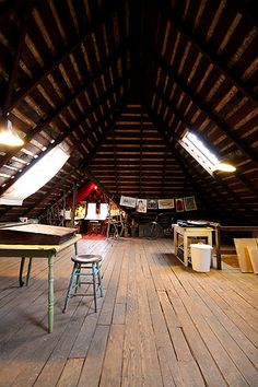 Evan b. harris' studio.  My attic has a pine tongue and grove ceiling and terrible carpet.  I have asked my husband several times to help me take the carpet out and expose the bare wood, I don't see that he can refuse me now.