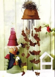 wind chime made of clay flower pot with dangling ducks and butterlies