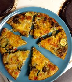 QUICHE Butternut squash, courgette, onion, pepper and mushroom filling 3 eggs, 3 egg whites and almond milk Mozzarella and cheddar to top