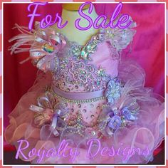 For sale. Darling Brand new! Gorgeous pink and lavender high glitz pageant dress. Size 2 to 3 or slim 5 Girls. Adjustable laced up back can fit size 2 to slim 4. I will accept payments. I will alter to fit perfectly. Made with Gorgeous AB point back rhinestones. Asking $850.00 and I will accept payments. Message me if interested. Comes with matching hair bow and bustle bow. Here's my website www.royaltydesigns.net. Glitz Pageant Hair, Kids Pageant Dresses, Toddlers And Tiaras, Romy Schneider, Pageants, Little Girl Hairstyles, Beauty Queens, Hair Bows, Rhinestones