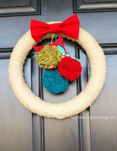 How to Make Fabric Pom Pom Christmas Wreath on http://www.craftaholicsanonymous.net