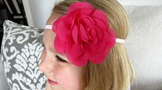 Simply beautiful! This baby headband features a chiffon flower in hot pink.The flower measures approximately 3.5 in diameter and is