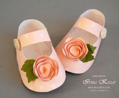 Paper baby shoes. This pair came from the blog Stampin' with Irina. She does many very pretty, delicate items.