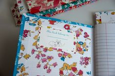 i want one....or ten!  love these fabric covered composition notebooks!!!