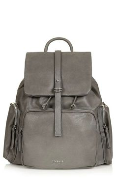 Free shipping and returns on Topshop Faux Leather Backpack at Nordstrom.com. Gleaming goldtone hardware and gilt logo letters lend an upscale look to a faux-leather backpack that's stylish and sturdy enough for travel. Three generous exterior zip pockets keep your oft-used items close at hand, while a spacious interior secures your tech and larger gear.