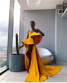 These 10 stunning yellow dress styles will make you yearn for more yellow dresses and gowns in your wardrobe. African Inspired Fashion, African Print Fashion, Africa Fashion, Fashion Prints, Ghana Fashion, Modern African Fashion, Ankara Fashion, African Prints, African Fabric