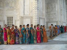 Beautiful saris - Entrance Line: The Taj Mahal, Agra, India - photo by Kim MacKinnon via smithsonianmag Saris, Agra, Taj Mahal India, Namaste, Pretty Pictures, Cool Photos, Bollywood, World Cultures, India Travel