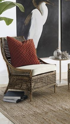 Two stylish high-back rattan chairs delight with two different looks. Marco gives a rattan twist to the traditional wingback.