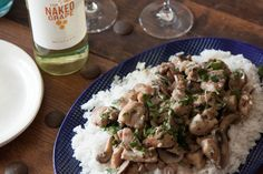 Lemon Herb Chicken Moscato is an easy weeknight meal of sautéed chicken thighs, a delicious moscato wine sauce and herbs and is served over rice.