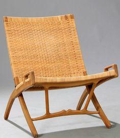 """Hans J. Wegner: """"JH 512"""". An oak folding chair."""