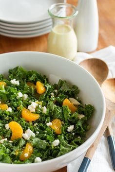 Kale Citrus Salad - earthy kale, citrusy dressing and mandarin oranges, plus creamy and salty goat cheese all come together in perfect harmony to create a fabulous kale salad that's high class enough for a formal dinner party, yet just as at home on a casual buffet. And only 5 minutes to prep! Ingredients available at Walmart.