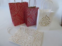 Dress up your gift bags by painting them with Wallovers Stencils!