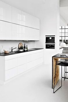 Modern Kitchen Interior White gloss cabinets with touch of wood. Don't like the black counter tops. White, minimal, with accents of bleached wood and, often, the odd design classic Modern Kitchen Interiors, Modern Kitchen Design, Interior Design Kitchen, Interior Ideas, Industrial Interiors, Kitchen Designs, Classic Kitchen, New Kitchen, Kitchen Decor