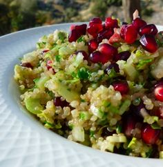 Quinoa Salad with Pomegranate | Traditional Foods http://www.traditional-foods.com/recipes/quinoa-salad/     3 cups cooked, cooled quinoa (soaked the night before and cooked in bone broth, of course)      2 cups thinly sliced celery     3 cups pomegranate seeds     1/2 cup finely minced parsley     2 tablespoons finely minced lemon balm or zest from one lemon     2 finely minced garlic cloves     1/2 cup light olive oil     Juice of a small lemon     1 cup broken and roasted walnuts
