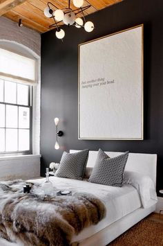 Love the black walls, the fur blanket on the bed, just everything is  perfect in this room.
