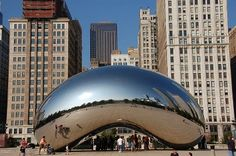 """Cloud Gate, a public sculpture by Anish Kapoor, in Millennium Park in Chicago, Illinois. The sculpture is nicknamed """"The Bean"""" because of its bean-like shape. Made up of 168 stainless steel plates welded together, its highly polished exterior has no visible seams. Said to have been inspired by liquid mercury, the sculpture's surface reflects and distorts the city's skyline. On the underside is the """"omphalos"""" (Greek for """"navel""""), a concave chamber that warps and multiplies reflections."""