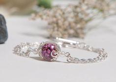 Best friends forever bracelet, with real pink heather flowers inside a blown glass bubble. Bracelet in silver. So pretty.