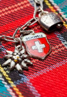 Switzerland,Swiss Flag On Charm Bracelet With Cow Bell And Edelweiss Stock Photos / Pictures / Photography / Royalty Free Images at Inmagine...